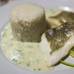 Gedünstetes Schollenfilet auf Weißweinmousseline mit Reis